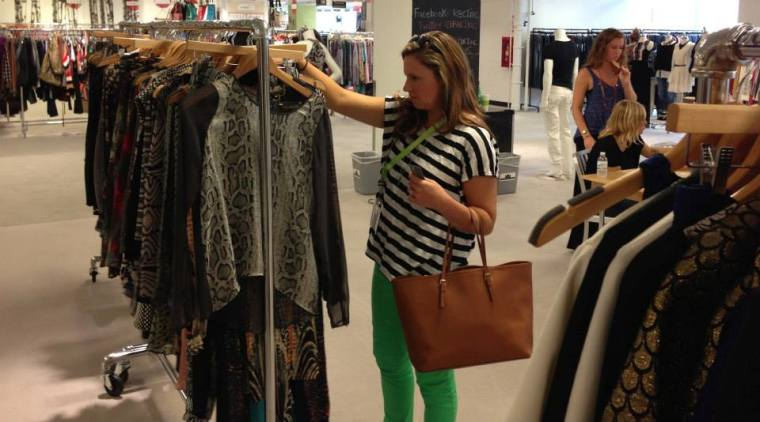 Chaley Chandler attends a market event to purchase clothing items for her boutique.